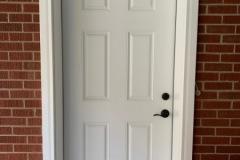 MADE ENTRY DOOR INTO BRICK WALL