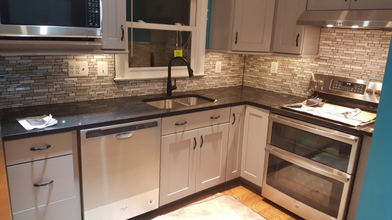 Kitchen grey cabinets with dark counter-tops