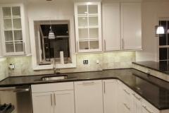 White kitchen and dark counters